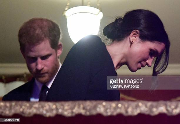 Britain's Prince Harry and his US fiancee Meghan Markle attends The Queen's Birthday Party concert on the occassion of Her Majesty's 92nd birthday at...