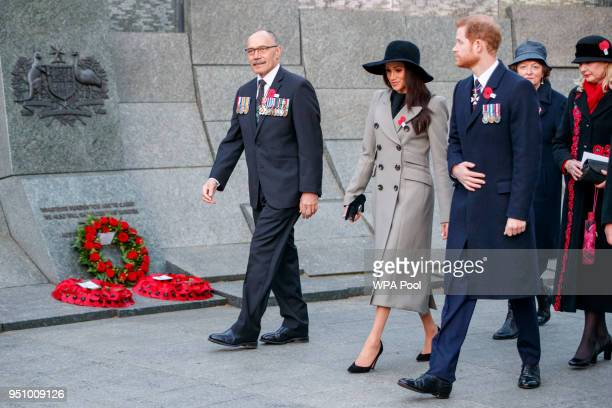 Britain's Prince Harry and his US fiancee Meghan Markle walk with New Zealand's High Commissioner to the United Kingdom Jerry Mateparae during attend...