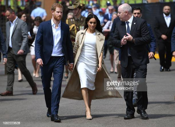 Britain's Prince Harry and his wife Meghan arrive at the Sydney Opera House in Sydney on October 16 2018 Prince Harry and Meghan have made their...
