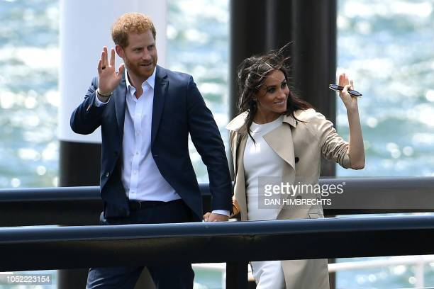 Britain's Prince Harry and his wife Meghan arrive by launch at the Sydney Opera House in Sydney on October 16 2018 Prince Harry and Meghan have made...