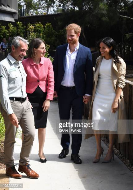Britain's Prince Harry and his wife Meghan chat with New South Wales Premier Gladys Berejiklian and Taronga Zoo CEO Cameron Kerr during a visit to...