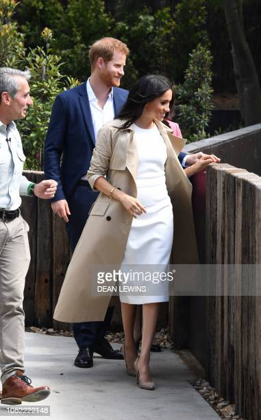 Britain's Prince Harry and his wife Meghan chat with Taronga Zoo CEO Cameron Kerr during a visit to Taronga Zoo in Sydney on October 16 2018 Prince...