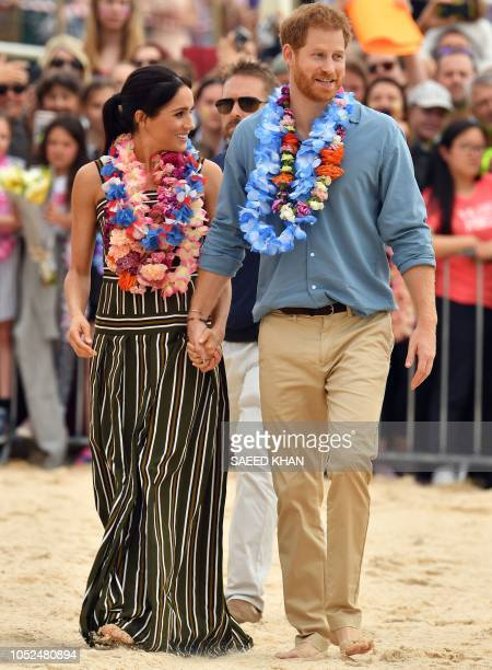Britain's Prince Harry and his wife Meghan Duchess of Sussex leave after a Fluro Friday session run by OneWave a local surfing community group who...