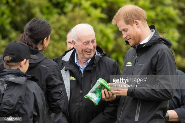 Britain's Prince Harry and his wife Meghan, Duchess of Sussex receive baby gumboots as a gift after a gumboot throwing competition following the...