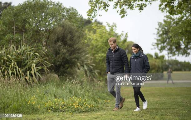 Britain's Prince Harry and his wife Meghan Duchess of Sussex visit Totaranui Campground in the Abel Tasman National Park on October 29 2018 Prince...