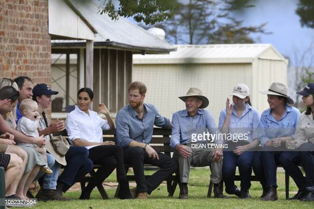 Britain's Prince Harry and his wife Meghan the Duchess of Sussex enjoy morning tea during a visit to the droughtaffected farm of Mountain View in...