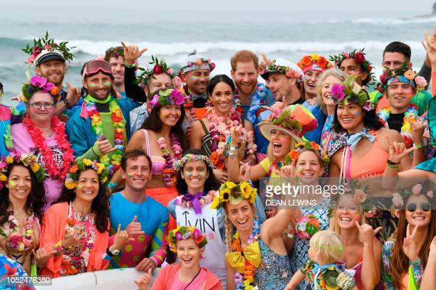 """Britain's Prince Harry and his wife Meghan, the Duchess of Sussex pose during a """"Fluro Friday"""" session run by OneWave, a local surfing community..."""