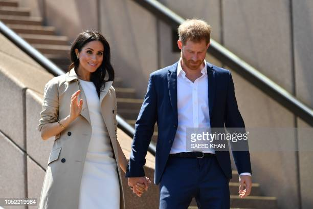Britain's Prince Harry and his wife Meghan walk down the stairs of Sydneys iconic Opera House to meet people in Sydney on October 16 2018 Prince...