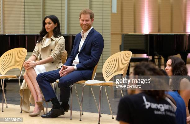 Britain's Prince Harry and his wife Meghan watch the rehearsal of Spirit 2018 being performed by the Bangarra Dance Theatre company during a visit to...