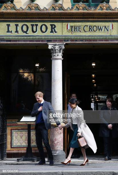 Britain's Prince Harry and Prince Harry's fiancee US actress Meghan Markle leave after a visit to one of Belfast's most historic buildings The Crown...