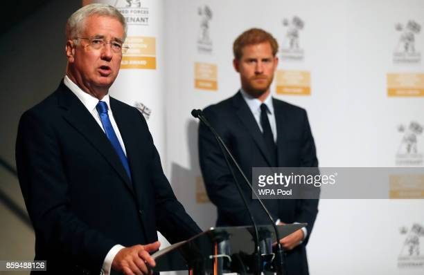 Britain's Prince Harry and Secretary of State for Defense Michael Fallon left present the Employer Recognition Scheme Gold Awards at the Imperial War...