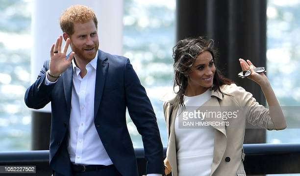 Britain's Prince Harry and wife Meghan arrive for a public walk at the Sydney Opera House in Sydney on October 16 2018 Prince Harry and Meghan have...