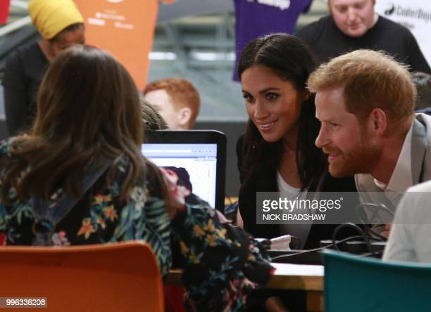 Britain's Prince Harry and wife Meghan, Duke and Duchess of Sussex visit the Dogpatch startup hub in Dublin on the final day of their trip on July...
