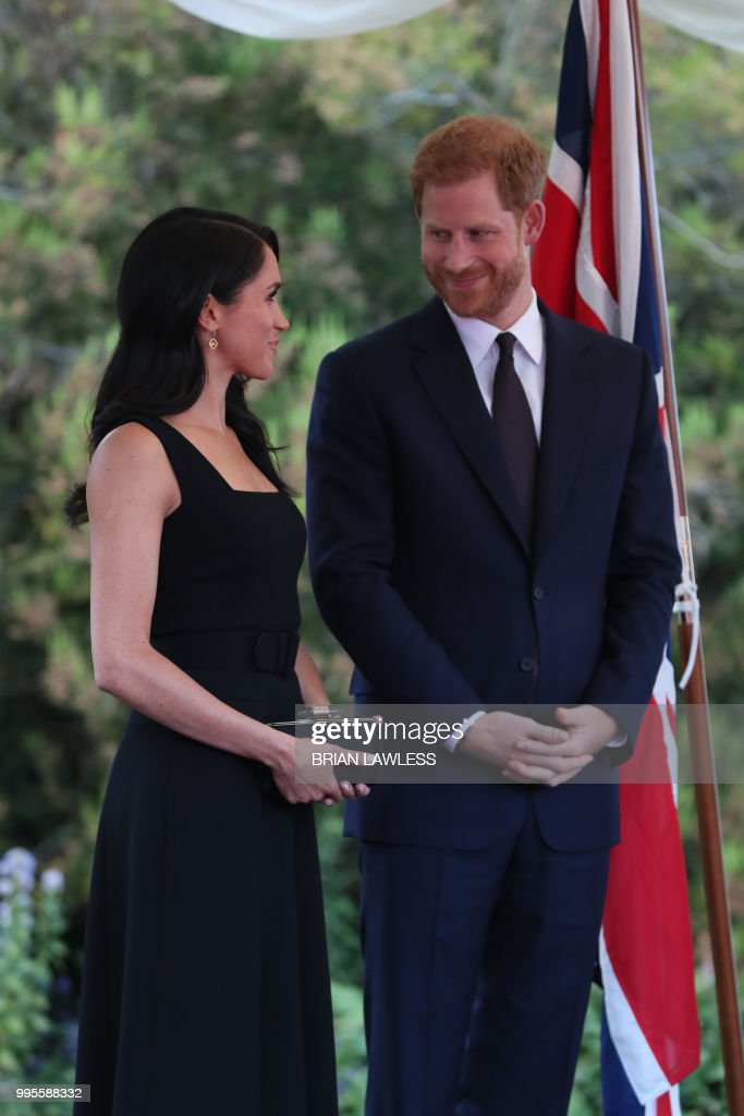 Britain's Prince Harry and wife Meghan, the Duke and ...