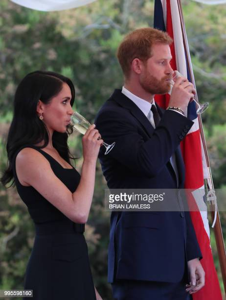 Britain's Prince Harry and wife Meghan the Duke and Duchess of Sussex attend a Summer Party at the British Ambassador's residence at Glencairn House...