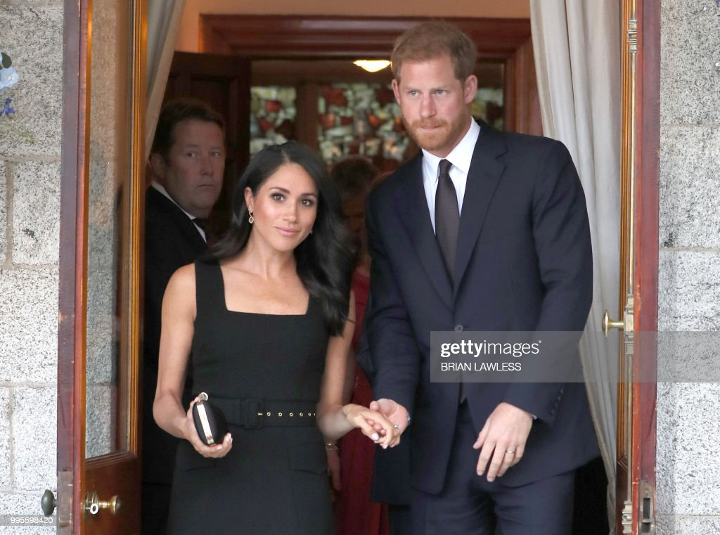 Britain's Prince Harry and wife Meghan, the Duke and Duchess of Sussex attend a Summer Party at the British Ambassador's residence at Glencairn House in Dublin at the start of their two day visit on July 10, 2018.