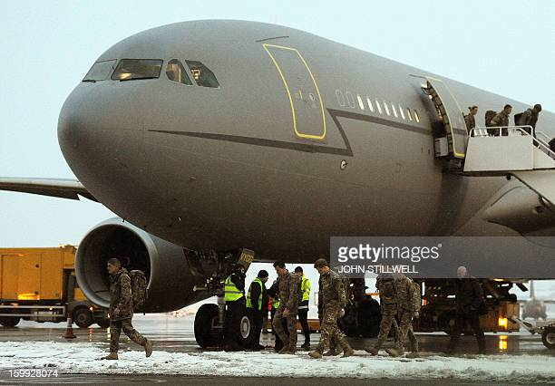 Britain's Prince Harry arrives at RAF Brize Norton in Oxfordshire on a British Royal Air Force A330 transport aircraft on January 23 2013 after...