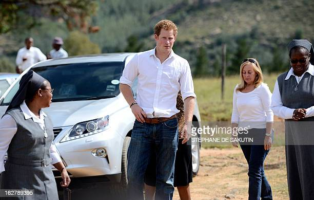 Britain's Prince Harry arrives on February 27, 2013 at the Kananelo Center for the Deaf in Maseru. The prince visited his charity projects in Lesotho...