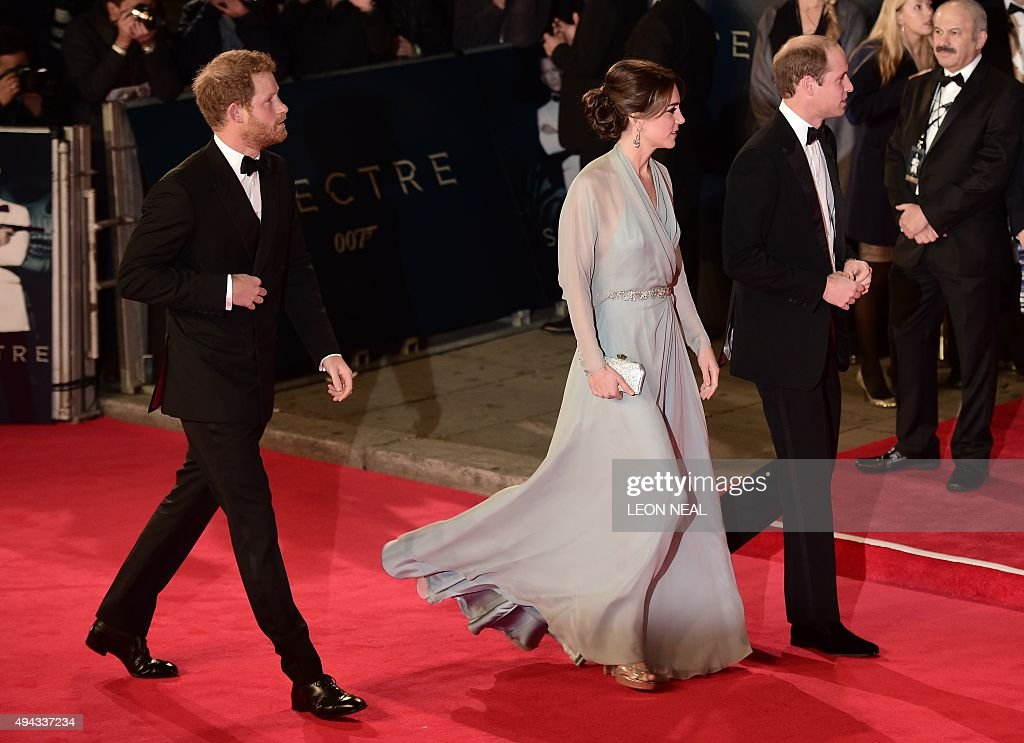 Britain's Prince Harry, Britain's Catherine, Duchess of Cambridge and Britain's William, Duke of Cambridge arrive for the world premiere of the new James Bond film 'Spectre' at the Royal Albert Hall in London on October 26, 2015. The film is directed by Sam Mendes and sees Daniel Craig play suave MI6 spy 007 for a fourth time. NEAL