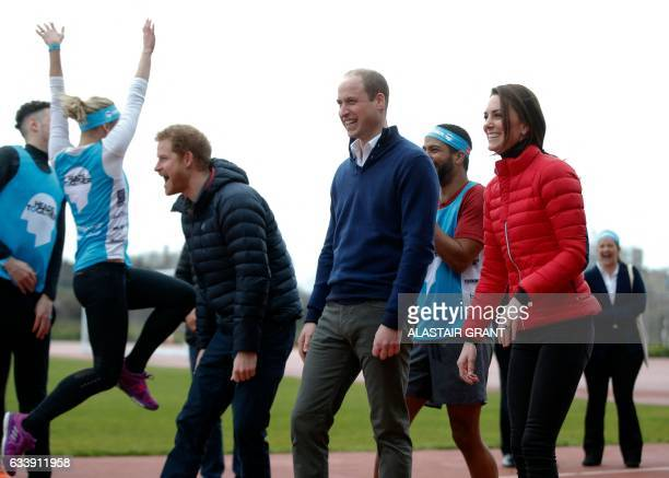 Britain's Prince Harry Britain's Catherine Duchess of Cambridge and Britain's Prince William Duke of Cambridge react as they take part in a relay...