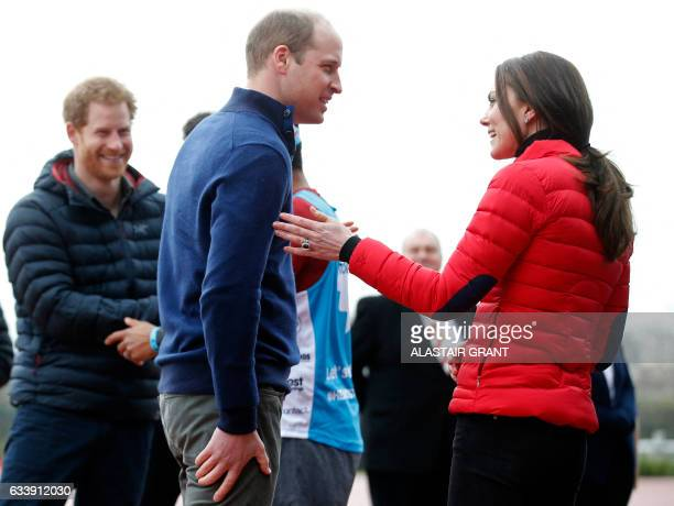 Britain's Prince Harry Britain's Catherine Duchess of Cambridge and Britain's Prince William Duke of Cambridge react after taking part in a short...