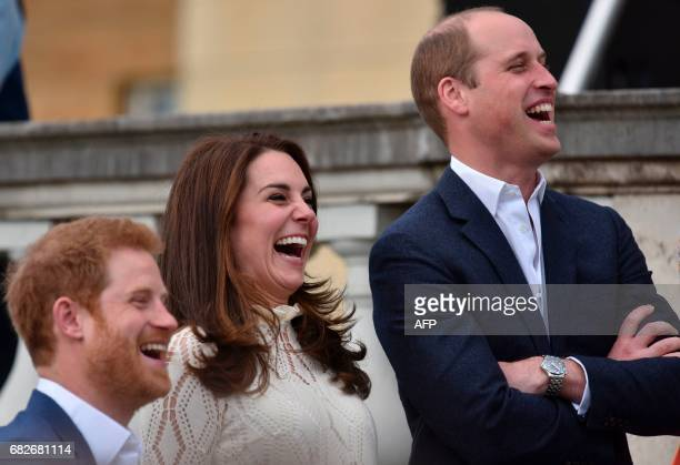 Britain's Prince Harry Britain's Catherine Duchess of Cambridge and Britain's Prince William Duke of Cambridge laugh as they host a Special Garden...