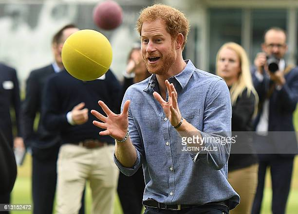 Britain's Prince Harry catches a ball as he takes part in a Coach Core sports coaching apprenticeship programme event at Lord's cricket ground in...