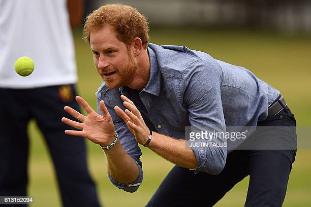 Britain's Prince Harry catches a tennis ball as he takes part in a Coach Core sports coaching apprenticeship programme event at Lord's cricket ground...