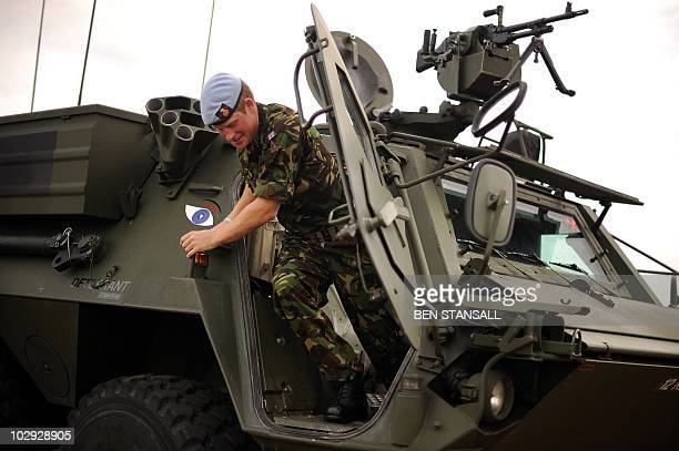 Britain's Prince Harry climbs out of an RAF Fuchs vehicle during a visit to RAF Honington in Suffolk easten England on July 14 2010 AFP PHOTO/BEN...
