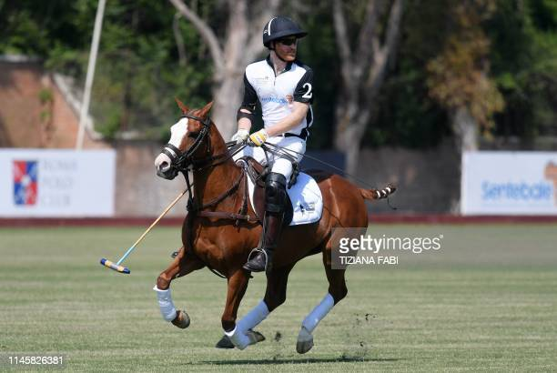 Britain's Prince Harry competes in a charity polo match the Sentebale ISPS Handa Polo Cup at the Roma Polo Club in Rome on May 24 2019 The annual...