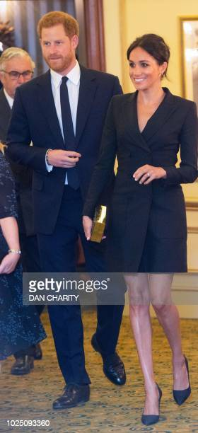 Britain's Prince Harry, Duke of Sussex , and Britain's Meghan, Duchess of Sussex arrive to attend a gala performance of the musical 'Hamilton' in...