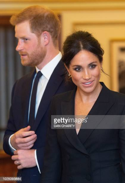 Britain's Prince Harry, Duke of Sussex, and Britain's Meghan, Duchess of Sussex arrive to attend a gala performance of the musical 'Hamilton' in...