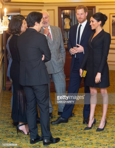 Britain's Prince Harry, Duke of Sussex and Britain's Meghan, Duchess of Sussex talk with US composer and writer Lin-Manuel Miranda and other guests...