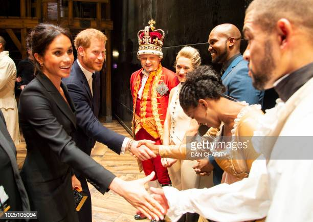 Britain's Prince Harry, Duke of Sussex, and Britain's Meghan, Duchess of Sussex meet members of the cast and crew backstage after a gala performance...