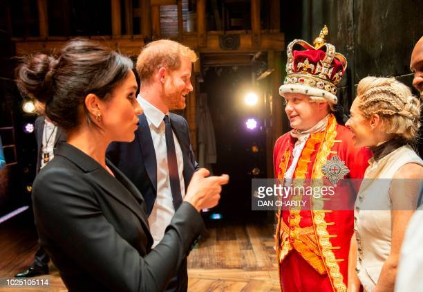 Britain's Prince Harry Duke of Sussex and Britain's Meghan Duchess of Sussex meet members of the cast and crew backstage after a gala performance of...