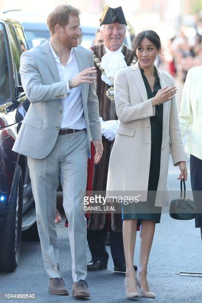 Britain's Prince Harry, Duke of Sussex, and Britain's Meghan, Duchess of Sussex greet well-wishers as they arrive in Chichester, West Sussex,...