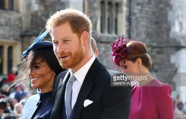 Britain's Prince Harry Duke of Sussex and Britain's Meghan Duchess of Sussex leave after attending the wedding of Britain's Princess Eugenie of York...