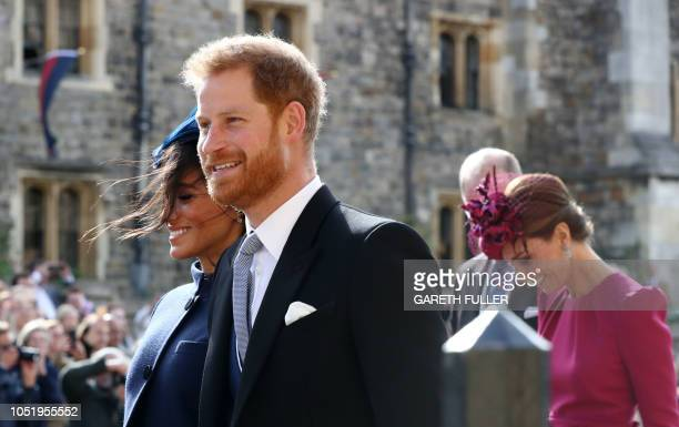Britain's Prince Harry Duke of Sussex and Britain's Meghan Duchess of Sussex leave with Britain's Catherine Duchess of Cambridge and Britain's Prince...
