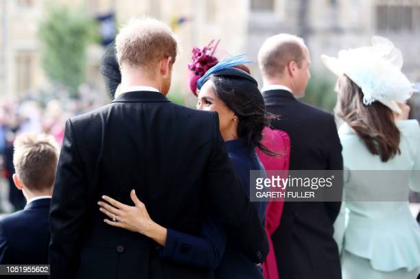 Britain's Prince Harry Duke of Sussex and Britain's Meghan Duchess of Sussex after attending the wedding of Britain's Princess Eugenie of York and...