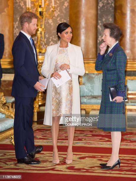 Britain's Prince Harry Duke of Sussex and Britain's Meghan Duchess of Sussex and Britain's Princess Anne Princess Royal attend a reception to mark...