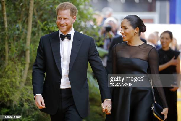 Britain's Prince Harry Duke of Sussex and Britain's Meghan Duchess of Sussex arrive for the European premiere of the film The Lion King in London on...