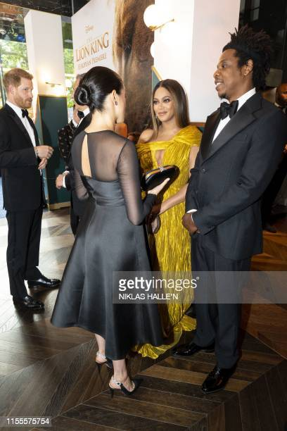 Britain's Prince Harry, Duke of Sussex and Britain's Meghan, Duchess of Sussex meets cast and crew, including US singer-songwriter Beyoncé and her...