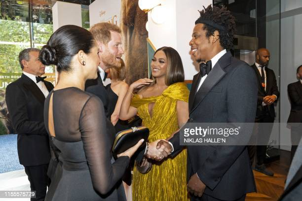 Britain's Prince Harry, Duke of Sussex and Britain's Meghan, Duchess of Sussex meet cast and crew, including US singer-songwriter Beyoncé and her...