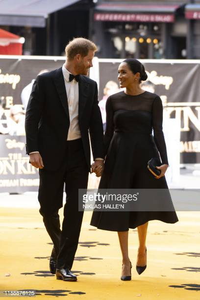 Britain's Prince Harry, Duke of Sussex and Britain's Meghan, Duchess of Sussex arrive to attend the European premiere of the film The Lion King in...