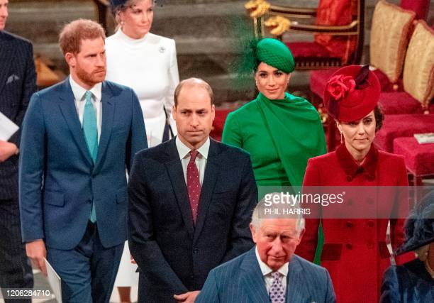Britain's Prince Harry, Duke of Sussex and Britain's Meghan, Duchess of Sussex follow Britain's Prince William, Duke of Cambridge and Britain's...