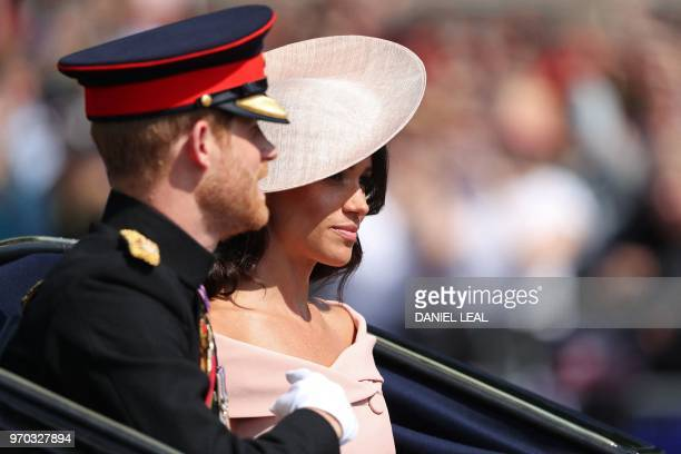 Britain's Prince Harry Duke of Sussex and Britain's Meghan Duchess of Sussex travel in a carriage to Horseguards parade ahead of the Queen's Birthday...