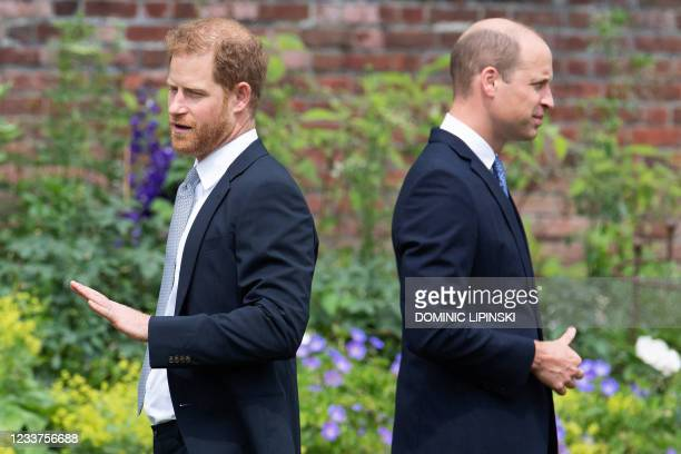 Britain's Prince Harry, Duke of Sussex and Britain's Prince William, Duke of Cambridge attend the unveiling of a statue of their mother, Princess...