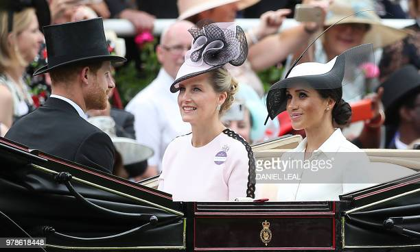Britain's Prince Harry Duke of Sussex and his wife Britain's Meghan Duchess of Sussex arrive with Britain's Sophie Countess of Wessex on day one of...