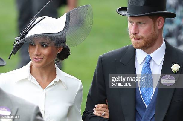 Britain's Prince Harry Duke of Sussex and his wife Britain's Meghan Duchess of Sussex attend day one of the Royal Ascot horse racing meet in Ascot...