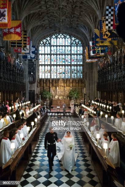 Britain's Prince Harry Duke of Sussex and his wife Britain's Meghan Markle Duchess of Sussex leave St George's Chapel after their wedding ceremony in...